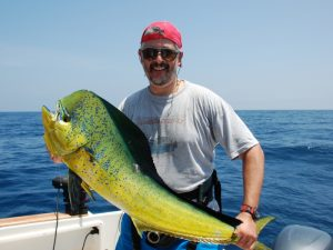 Fishing Zanzibar Angler with a bull Dorado
